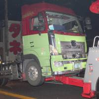 A trailer truck is seen being removed Saturday evening after it hit people taking part in a festival in Kanonji, Kagawa Prefecture. | KYODO