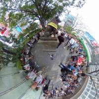 The bronze statue of the dog Hachiko in front of Shibuya Station in Tokyo pops out from the crowd in this Sept. 25 image. | YOSHIAKI MIURA