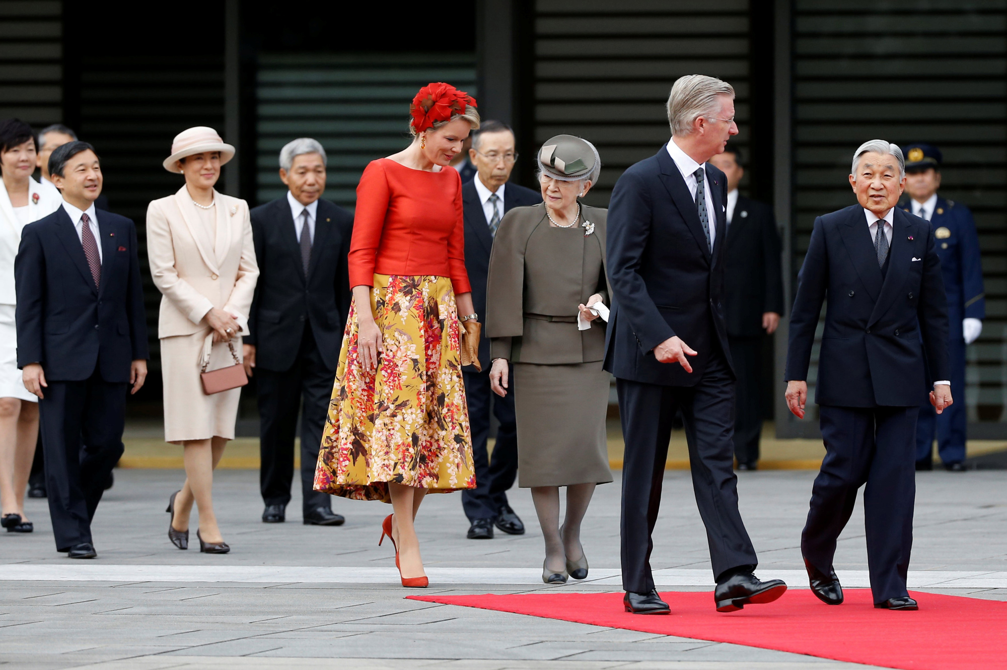 Belgium's King Philippe and Queen Mathilde are escorted by Emperor Akihito and Empress Michiko as Crown Prince Naruhito and Crown Princess Masako look on during a welcoming ceremony at the Imperial Palace in Tokyo on Tuesday. | REUTERS