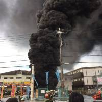 Black smoke billows from a Tokyo Electric Power Co. Holdings Inc. facility in Niiza, Saitama Prefecture, in this photo posted by Twitter user Watson_Yuki on Wednesday.