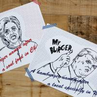 Campaign posters of Mr. and Mrs. burgers featuring U.S. presidential candidates Hillary Clinton and Donald Trump are displayed at J.S. Burgers Cafe in Tokyo on Oct. 7. | REUTERS