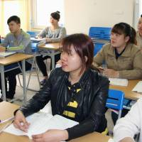 Do Thi Hang takes a Japanese language class in Hanoi in March. Some former classmates have given up hopes of becoming carers and took work in Japan in unrelated fields, such as food processing. | KYODO