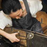 This photograph of a craftswoman working on molten glass by Pierre Wolf, spouse of the Guatemalan ambassador, was awarded the Prince Takamado Memorial Prize for capturing scintillating aspects of Japan's culture. | PIERRE WOLF