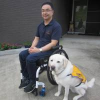 Service dog user hopes Tokyo Olympics raise awareness of owners' public rights