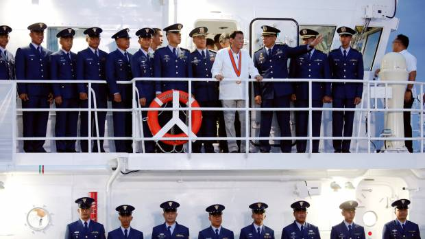 Duterte arrives in Japan after softening comments on 'separation' from U.S.
