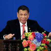 Philippine President Rodrigo Duterte speaks in Beijing on Thursday. | REUTERS