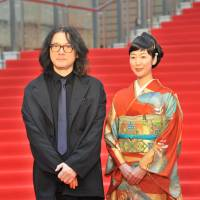 Filmmaker Shunji Iwai and actress Haru Kuroki appear on the red carpet at the Tokyo International Film Festival in the Roppongi district Tuesday. Iwai directed 'A Bride for Rip Van Winkle,' in which Kuroki starred. | YOSHIAKI MIURA