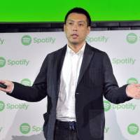 Akira Nomoto, director of licensing and label relations at Spotify Japan K.K., speaks at a news conference in Tokyo on Sept. 26.   YOSHIAKI MIURA