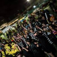 Participants in the Zombie Party parade from Aoyama to Shibuya on Oct. 31 last year in a photo provided by the organizer.