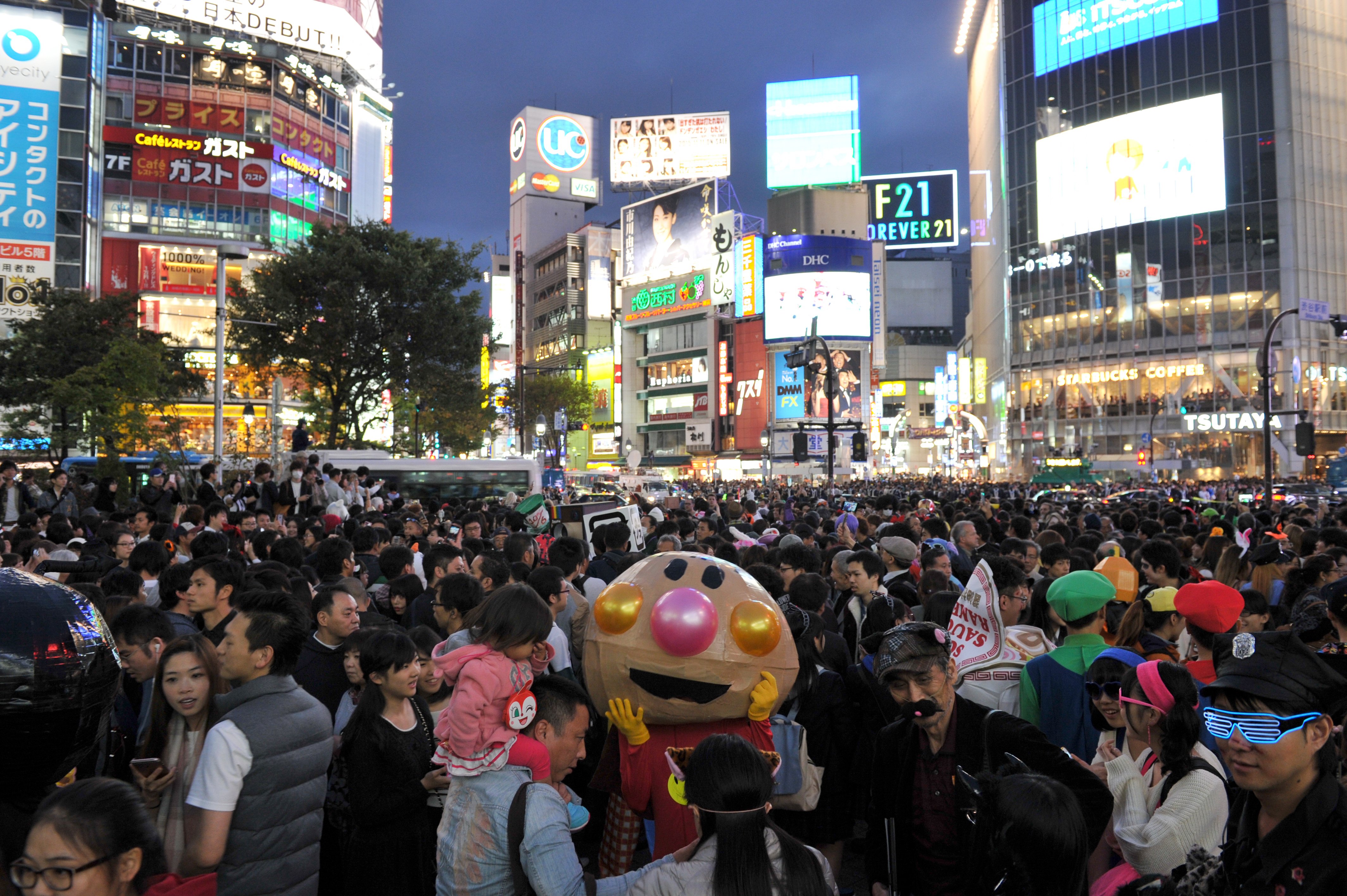 A large crowd of revelers mill about in Hachiko Square in front of JR Shibuya Station in Tokyo on Oct. 31, 2015. | YOSHIAKI MIUIRA