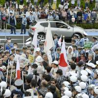 Organizers of a hate speech rally and people who oppose the display clash in a park in Kawasaki in June. | KYODO