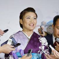 Olympic gold medal-winning wrestler Kaori Icho, who was on Thursday awarded the People's Honor Award on Thursday, speaks to reporters at a Tokyo hotel later the same day. | KYODO
