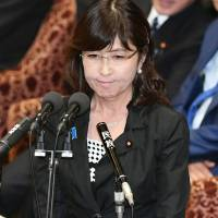 Defense Minister Tomomi Inada appears to fight back tears when grilled by opposition lawmaker Kiyomi Tsujimoto during a Lower House Budget Committee meeting Friday. | KYODO