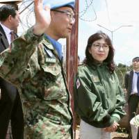 Defense Minister Tomomi Inada listens as the head of the Ground Self-Defense Force contingent speaks in Juba, South Sudan, on Saturday. | POOL / VIA KYODO
