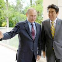 Japan mulls deal to retrieve Russian-held isles by banning U.S. military from using them