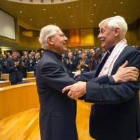 The Rev. Arturo Sosa (right), from Venezuela, is congratulated by the Rev. Adolfo Nicolas after being elected as superior general of the Society of Jesus in Rome on Friday. | AP