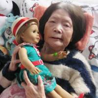 Tsuyako Matsumoto holds a doll sent to her by U.S. Ambassador Caroline Kennedy in Kitami, Hokkaido, in March. | KYODO