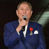 Japanese film director Takeshi Kitano meets with reporters in Paris on Tuesday after he was awarded the title of officer, the fourth degree in the five-ranked Legion of Honor. | KYODO