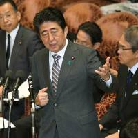 Prime Minister Shinzo Abe speaks during a special committee at the Lower House on Tuesday. | KYODO