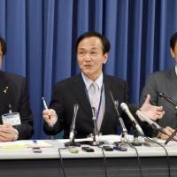 Sakai municipal officials explain the case of a missing boy Tuesday at the government office in Sakai, Osaka Prefecture. | KYODO