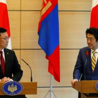 Mongolian Prime Minister Jargaltulga Erdenebat and Prime Minister Shinzo Abe hold a joint news conference in Tokyo on Friday. | REUTERS