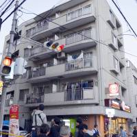 An apartment in Nishiyodogawa Ward, Osaka Prefecture, where a high school student was found dead Monday afternoon, is seen. | KYODO