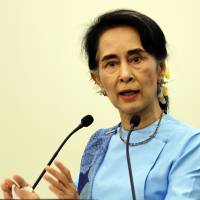 Myanmar leader Aung San Suu Kyi speaks at a meeting in the administrative capital of Naypyitaw on Oct. 22. | AP