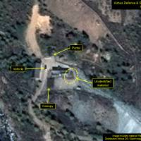 Activity is seen at one of three tunnel entrances at North Korea's Punggye-ri nuclear test site in this Oct. 1 image. | AIRBUS DEFENSE & SPACE / PLEIADES CNES 2016 / 38 NORTH