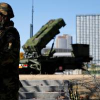 Members of the Ground Self-Defense Force guard a Patriot anti-missile battery outside the Defense Ministry in Tokyo in 2012. | REUTERS