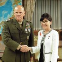 Gen. Robert Neller (left), commandant of the U.S. Marine Corps, and Defense Minister Tomomi Inada shake hands in Tokyo on Wednesday. | KYODO