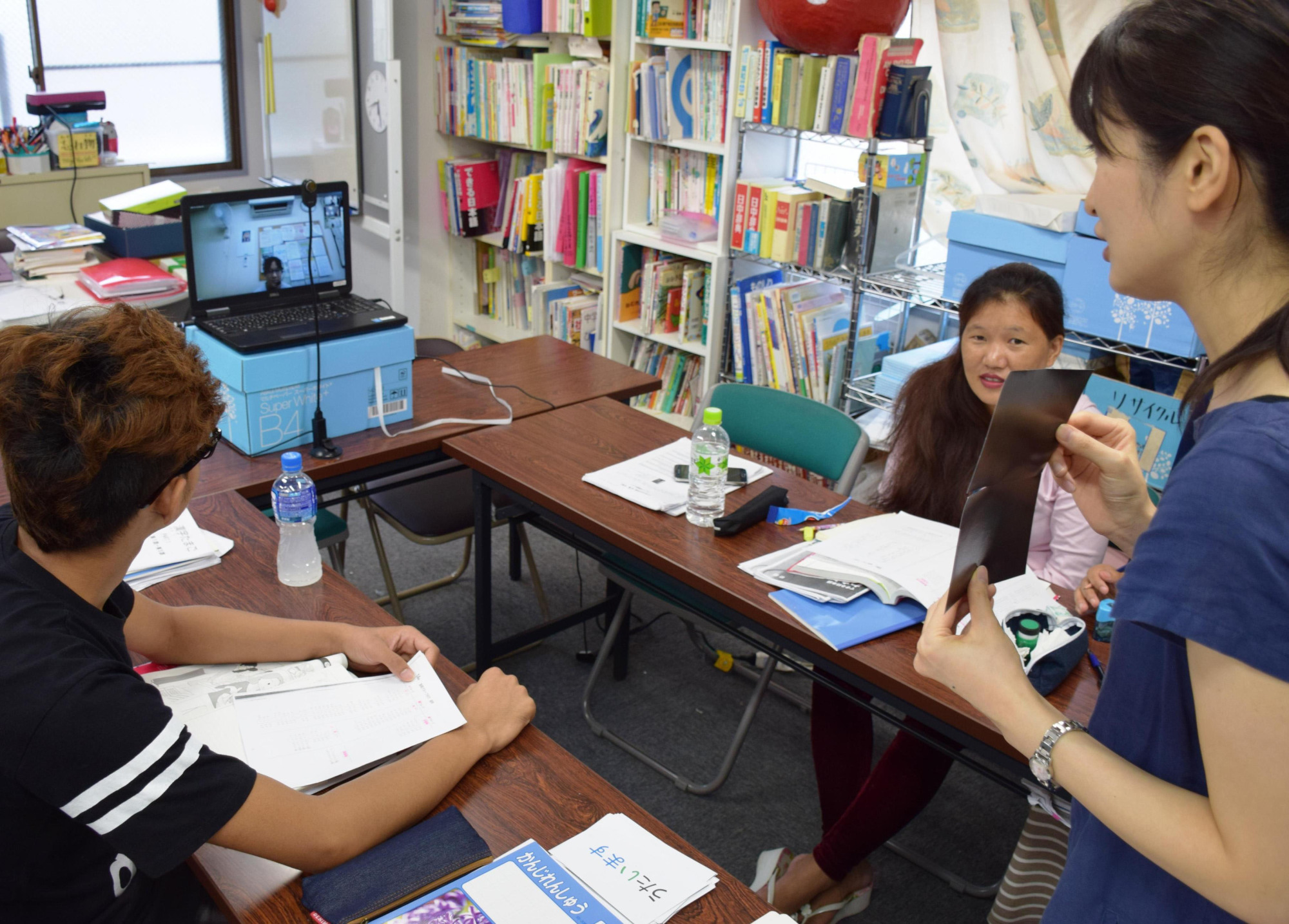 Members of Youth Support Center rehearse an online Japanese-language class for children on Sept. 15. | KYODO