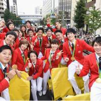 Rio de Janeiro Olympic medalists pose for a photo aboard a bus as they take part in a parade in Tokyo on Friday. | POOL/ VIA KYODO