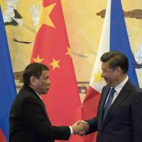 Philippine President Rodrigo Duterte meets with Chinese President Xi Jinping in Beijing on Thursday as part of a charm offensive that is aimed at seeking trade and support from the neighboring economic giant. | AP