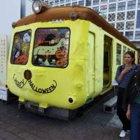 Aogaeru (green frog), an iconic train car that sits in front of JR Shibuya Station near the famous Hachiko statue, is seen Thursday dressed up to look like Sanrio's popular character Pom Pom Purin in an effort to prevent vandalism on Halloween night. | DAISUKE KIKUCHI