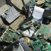 The scrap containing printed circuit boards seen in this undated photo was sent back to Japan from Thailand. | KYODO