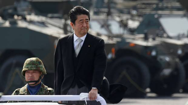 Expect greater dangers abroad, Abe warns SDF at troop review