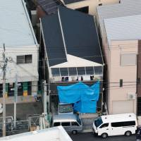 A man was arrested Wednesday on suspicion of breaking into this home in Kadoma, Osaka Prefecture, killing a father and injuring his three children. | KYODO