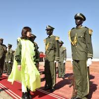 Defense Minister Tomomi Inada reviews an honor guard in the South Sudan capital Juba on Oct. 8, before inspecting the activities of Ground Self-Force Defense personnel participating in the U.N. peacekeeping mission there. | POOL / VIA KYODO