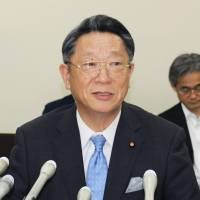Shinichi Maruyama speaks about his dubious use of political funds Wednesday at a press conference in the Gifu Municipal Government office. | KYODO