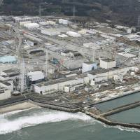 The Fukushima No. 1 nuclear plant, operated by Tokyo Electric Power Company Holdings Inc., is seen from the air in March. | KYODO