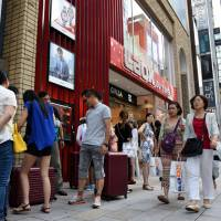 Chinese tourists flock to a duty-free electronics store in the posh Ginza district in Tokyo in September 2015. | SATOKO KAWASAKI
