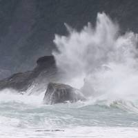 High waves brought by Typhoon Chaba hit a beach on Amami Oshima Island in Okinawa Prefecture on Monday. | KYODO