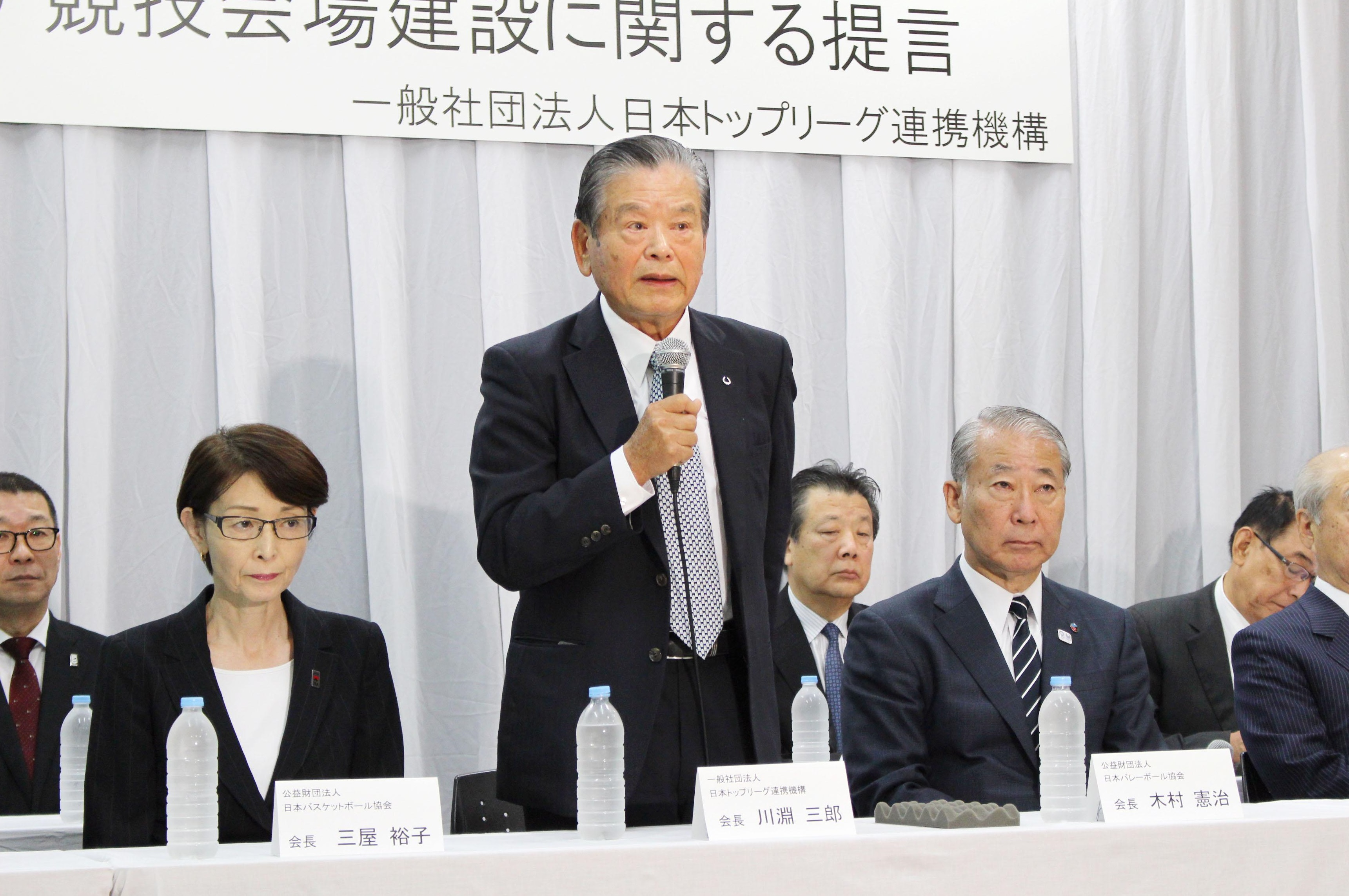 Saburo Kawabuchi, head of the Alliance of Japan Top Leagues, speaks at a news conference Wednesday in Tokyo about the construction of the Ariake Arena volleyball venue for the Tokyo 2020 Olympics. | KYODO