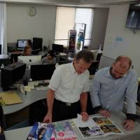 Serving the metropolis: 'You can't afford to make an 80-page magazine in Tokyo these days — it is impossible — and the staff that goes into making that content,' says Metropolis Chief Operating Officer Neil Butler (second from right), seen here with Creative Director Joshua McDowell at the monthly's office in Nishi-Azabu, Tokyo. | COURTESY OF METROPOLIS