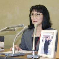 Yukimi Takahashi, mother of Matsuri Takahashi, speaks to reporters at the health ministry on Oct. 7, after Matsuri's death was ruled to have been work-related by a labor standards inspection office in Tokyo. | KYODO