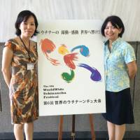 Mutsuko Kawakami (right), director general of the sixth Worldwide Uchinanchu Festival's executive committee, stands with Meiko Yonehara, public relations chief, at the Okinawa prefectural offices. | JON MITCHELL
