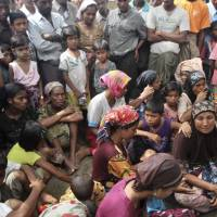 Muslim refugees wait for assistance at a camp in Sittwe, Rakhine state, western Myanmar, in October 2012.   AP