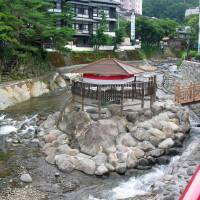 Healing waters: A tiny open-air foot bath in Shuzenji called Dokko no yu is supposedly the oldest hot-spring bath on the Izu Peninsula. | COURTESY IZU TOURISM