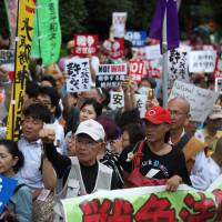 Loud and proud: Protesters take part in a rally against the security bills in Tokyo in 2015. | BLOOMBERG
