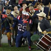 The New England Patriots' LeGarrette Blount celebrates a touchdown against the Houston Texans with the End Zone Militia at Gillette Stadium in Foxborough, Massachusetts, on Sept. 22. | WINSLOW TOWNSON / USA TODAY SPORTS / REUTERS